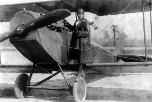Bessie Coleman and her plane, c.1922