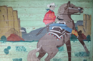 Murals of cowboy scenes probably painted in the 1930s are on four walls of a room in the trusty barracks at Kaufman County Poor Farm.